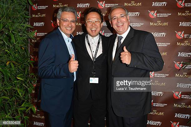 Samuel Hadida Tetsu Fujimura and Victor Hadida attend the Metropolitan Filmexport 35th Anniversary Party at Magnum Beach on May 19 2014 in Cannes...