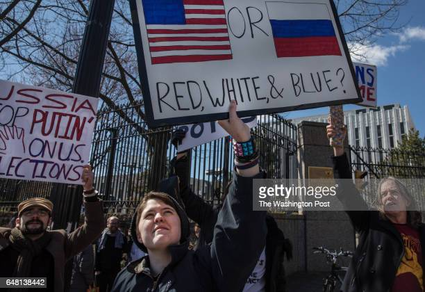 Samuel Hamblin a student at Loudon Valley High School demonstrates outside the Russian Embassy against President Donald Trump's relationship with...