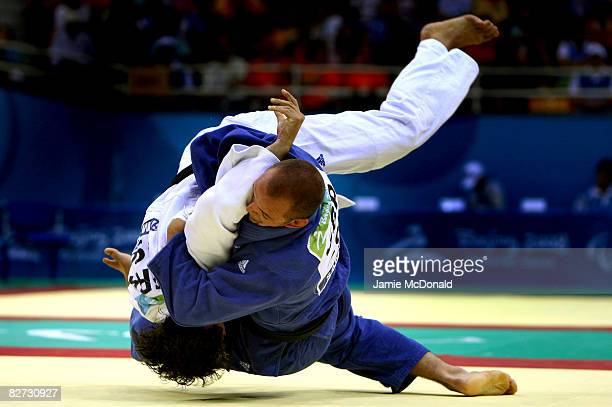 Samuel Ingram of Great Britain competes in the Judo -90 kg match against Olivier Cugnon de Servicourt of France at the Beijing Workers' Gymnasium...