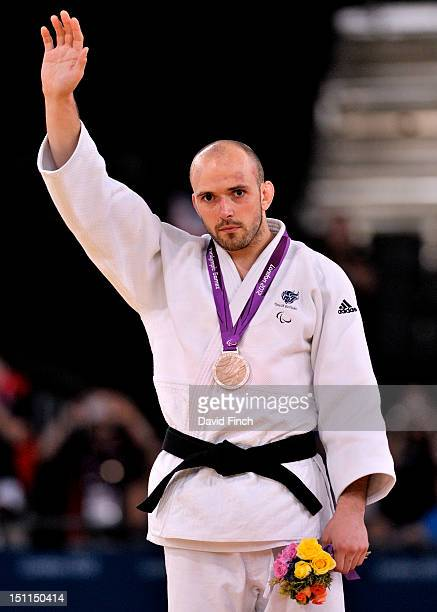 Samuel Ingram of Great Britain with the silver medal presented during the u90kgs medal presentation on Day 3 of the London 2012 Paralympic Games at...