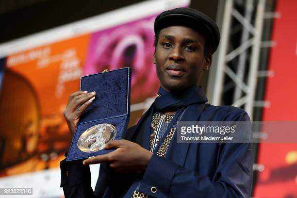 Samuel Ishimwe winner of the Silver Bear Jury Prize for the movie 'Imfura' poses at the Award Winners press conference during the 68th Berlinale...