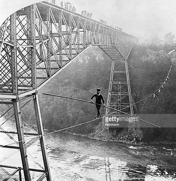 Samuel J Dixon of Toronto walks across the Niagara River Gorge on a 7/8inch rope above the Whirlpool Rapids on September 6 1890 Dixon crossed from...