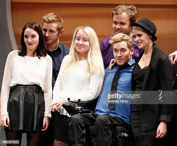 Samuel Koch poses with his girlfriend Sarah Elena Timpe friends and crew members after the last broadcast of the Wetten dass tv show on December 13...