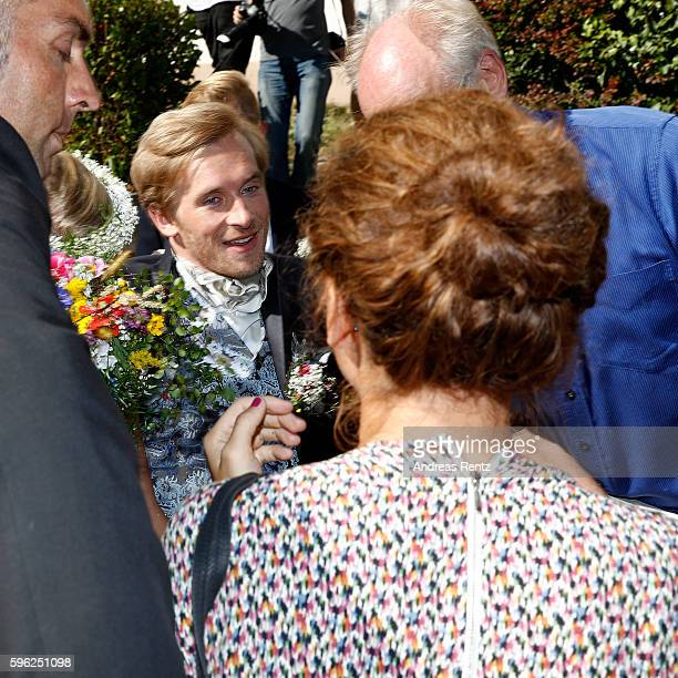 Samuel Koch talks to guests after his wedding with Sarah Elena Timpe at the local church on August 27 2016 in Mappach near EfringenKirchen Germany