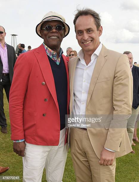 Samuel L Jackson and Andre Konsbruck Director of Audi UK attend day one of the Audi Polo Challenge at Coworth Park on May 30 2015 in London England