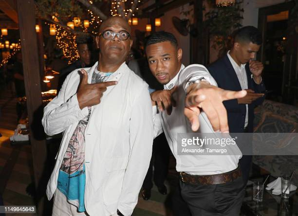 Samuel L Jackson and Jessie T Usher attend the Shaft Opening Night Party At Cecconi's Miami Beach on June 12 2019 in Miami Florida