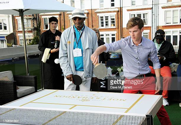 Samuel L Jackson and Luke Treadaway play table tennis at The Moet Chandon Suite at The Aegon Championships Queens Club finals on June 16 2013 in...