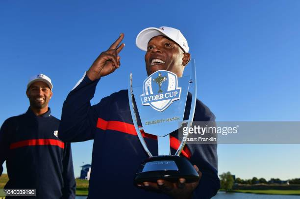 Samuel L Jackson of Team USA celebrates victory with the trophy after the celebrity challenge match ahead of the 2018 Ryder Cup at Le Golf National...
