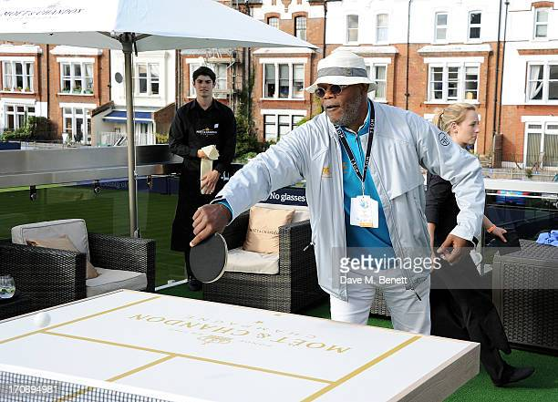 Samuel L Jackson plays table tennis at The Moet Chandon Suite at The Aegon Championships Queens Club finals on June 16 2013 in London England