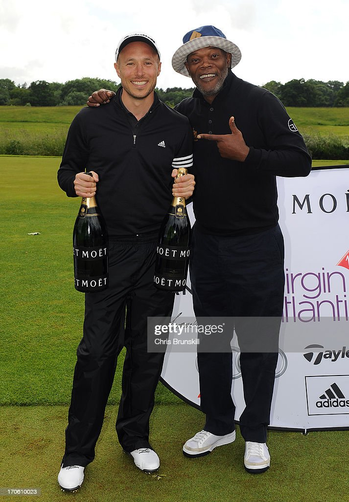 Samuel L Jackson (R) presents individual tournament winner Justin James with a bottle of Moet & Chandon champagne during the Affinity Real Estate Shooting Stars Benefit Second Round at The Grove Hotel on June 15, 2013 in Hertford, England.