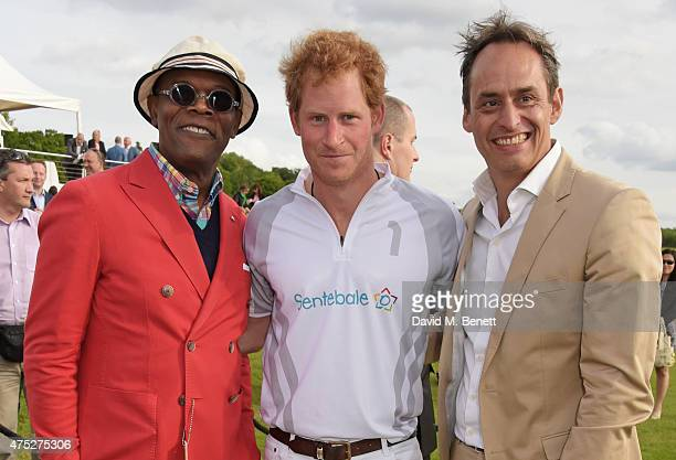 Samuel L Jackson Prince Harry and Andre Konsbruck Director of Audi UK attend day one of the Audi Polo Challenge at Coworth Park on May 30 2015 in...