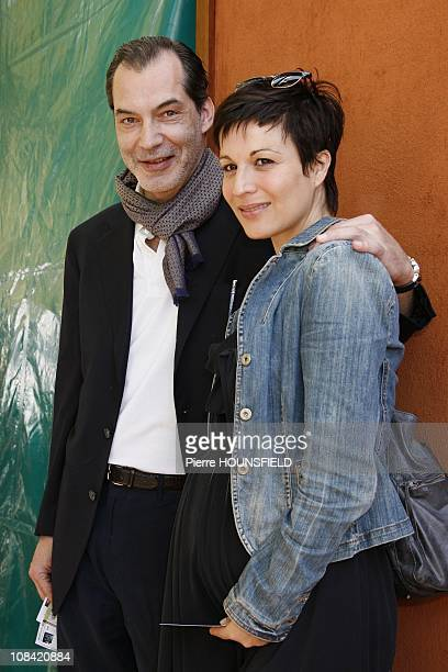 Samuel Labarthe and his wife Helene Medigue in Paris France on May 30 2009