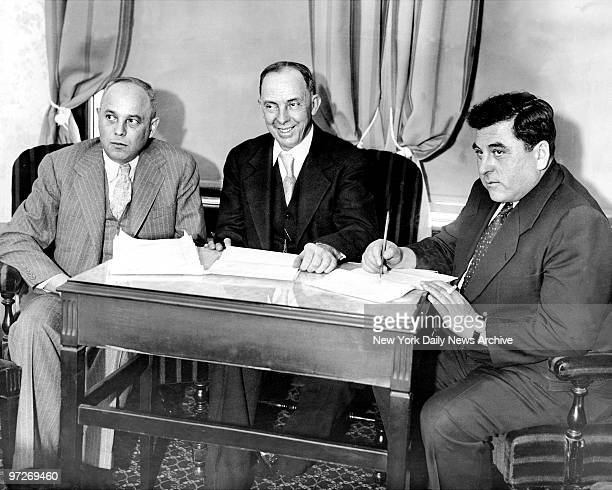 Samuel Leibowitz George W Chamlee and Joseph R Brodsky the defense counsel for the Scottsboro trial in conference at Tutwiler Hotel in Birmingham...