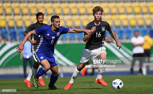 Samuel Lengle of Germany and Or Blorian of Israel vie for the ball during the Under 17 four nations tournament match between U17 Germany and U17...