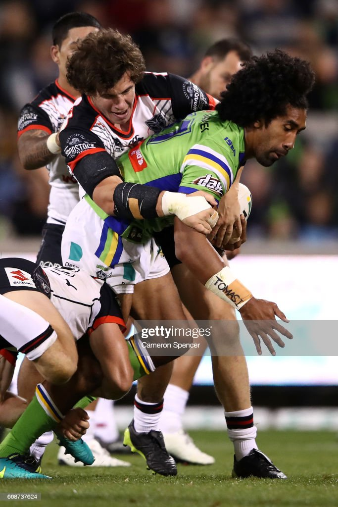 Samuel Lisone of the Warriors is tackled during the round seven NRL match between the Canberra Raiders and the New Zealand Warriors at GIO Stadium on April 15, 2017 in Canberra, Australia.