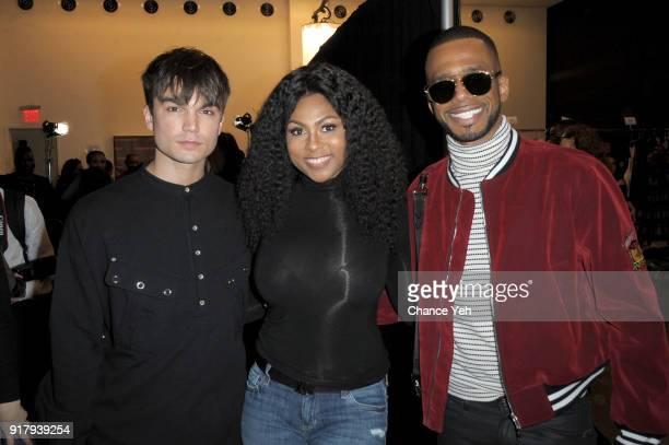Samuel Mancini Tashiana Washington and Eric West pose backstage for Vivienne Tam during New York Fashion Week at Spring Studios on February 13 2018...