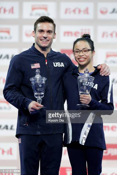 Samuel Mikulak and Morgan Hurd of the United States celebrate as they pose with the 2019 Artistic Gymnastics World Cup Series AllAround Winner cup...