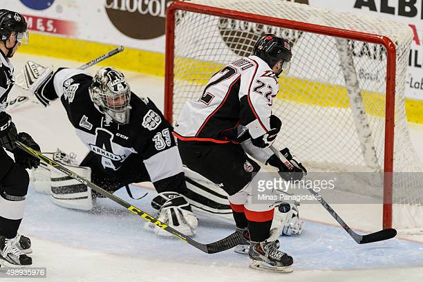 Samuel Montembeault of the Blainville-Boisbriand Armada makes a pad save on Peter Abbandonato of the Rouyn-Noranda Huskies during the QMJHL game at...