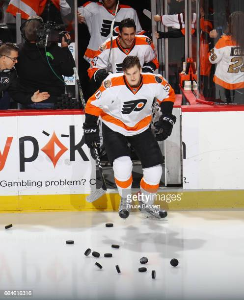 Samuel Morin and Mike Vecchione of the Philadelphia Flyers skate out for warmups prior to playing in their first NHL game against the New Jersey...