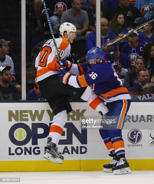Samuel Morin of the Philadelphia Flyers is checked by Andrew Ladd of the New York Islanders during the third period during a preseason game at the...