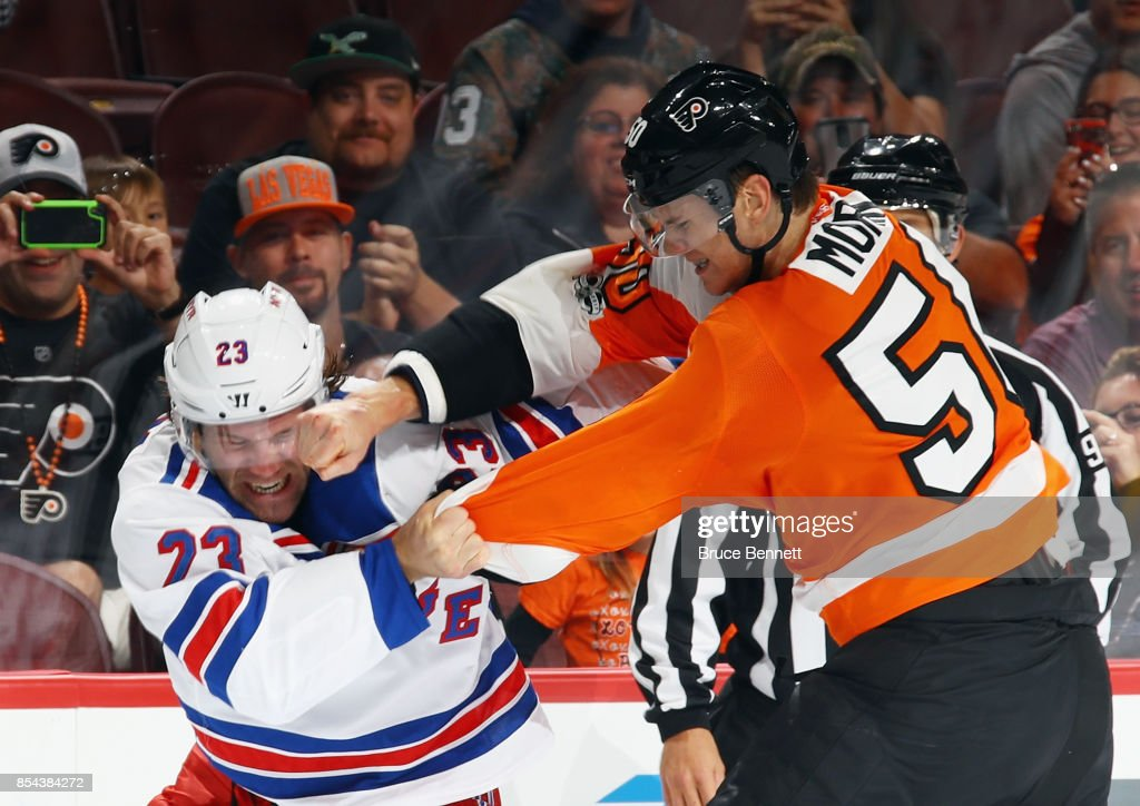 Samuel Morin #50 of the Philadelphia Flyers lands a punch during a first-period fight against Bobby Farnham #23 of the New York Rangers during a preseason game at the Wells Fargo Center on September 26, 2017 in Philadelphia, Pennsylvania.