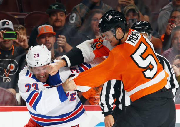 Samuel Morin of the Philadelphia Flyers lands a punch during a first-period fight against Bobby Farnham of the New York Rangers during a preseason...