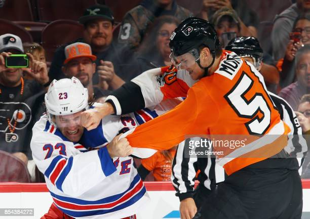 Samuel Morin of the Philadelphia Flyers lands a punch during a firstperiod fight against Bobby Farnham of the New York Rangers during a preseason...