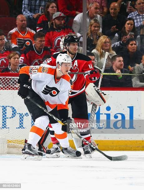 Samuel Morin of the Philadelphia Flyers playing in his first NHL game battles for position in front of the net against Adam Henrique of the New...