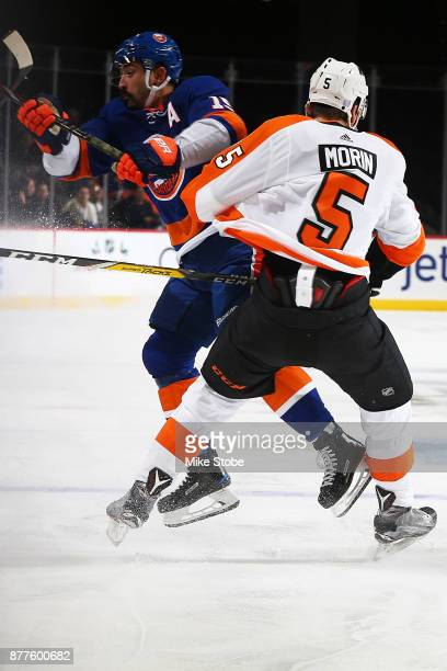 Samuel Morin of the Philadelphia Flyers steps up to check Cal Clutterbuck of the New York Islanders during the first period of a game at Barclays...