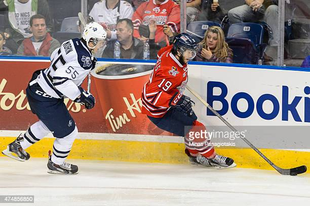 Samuel Morin of the Rimouski Oceanic skates close behind Cole Cassels of the Oshawa Generals as he moves the puck in Game Two during the 2015...