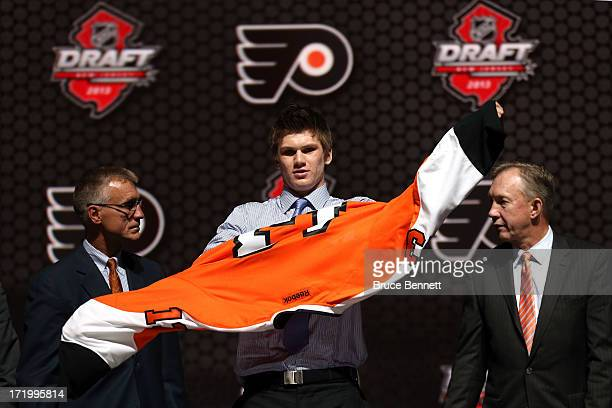 Samuel Morin poses with the General Manager Paul Holmgren and John Paddock Assistant General Manager after being selected number eleven overall in...