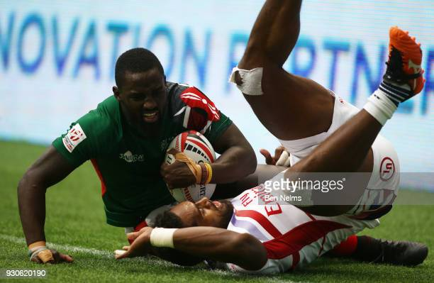 Samuel Oliech of Kenya is tackled by Matai Leuta of the United States away during the Canada Sevens the Sixth round of the HSBC Sevens World Series...