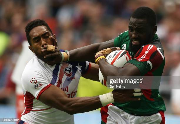 Samuel Oliech of Kenya pushes Matai Leuta of the United States away during the Canada Sevens the Sixth round of the HSBC Sevens World Series at the...