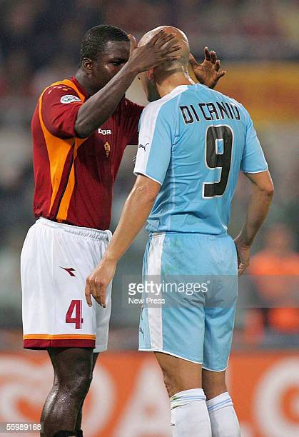 Samuel Osei Kuffour of Roma gestures to Paolo di Canio of Lazio during the Serie A football match between Roma and Lazio at the Olympic stadium on...