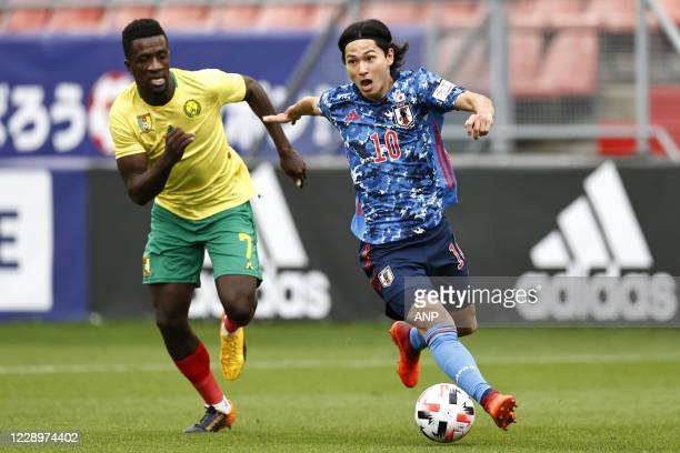 Samuel Oum Gouet of Cameroon, Takumi Minamino or Japan during the friendly match between Japan and Cameroon at Stadion Galgenwaard on October 09,...
