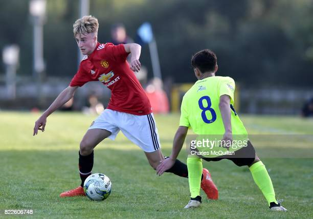 Samuel Peplow of Manchester United and Jesus Bravo of Colina during the NI Super Cup junior section game between Manchester United and Colina at...