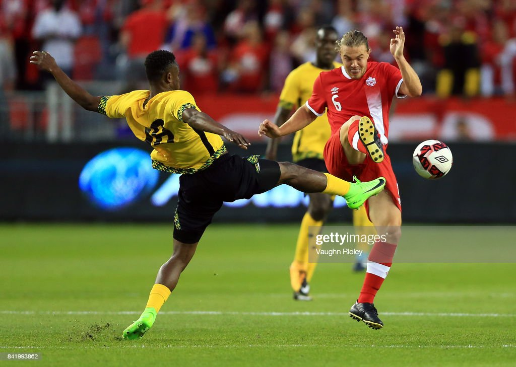 Samuel Piette #6 of Canada battles for the ball with Dane Kelly #16 of Jamaica during the first half of an International Friendly match at BMO Field on September 2, 2017 in Toronto, Canada.