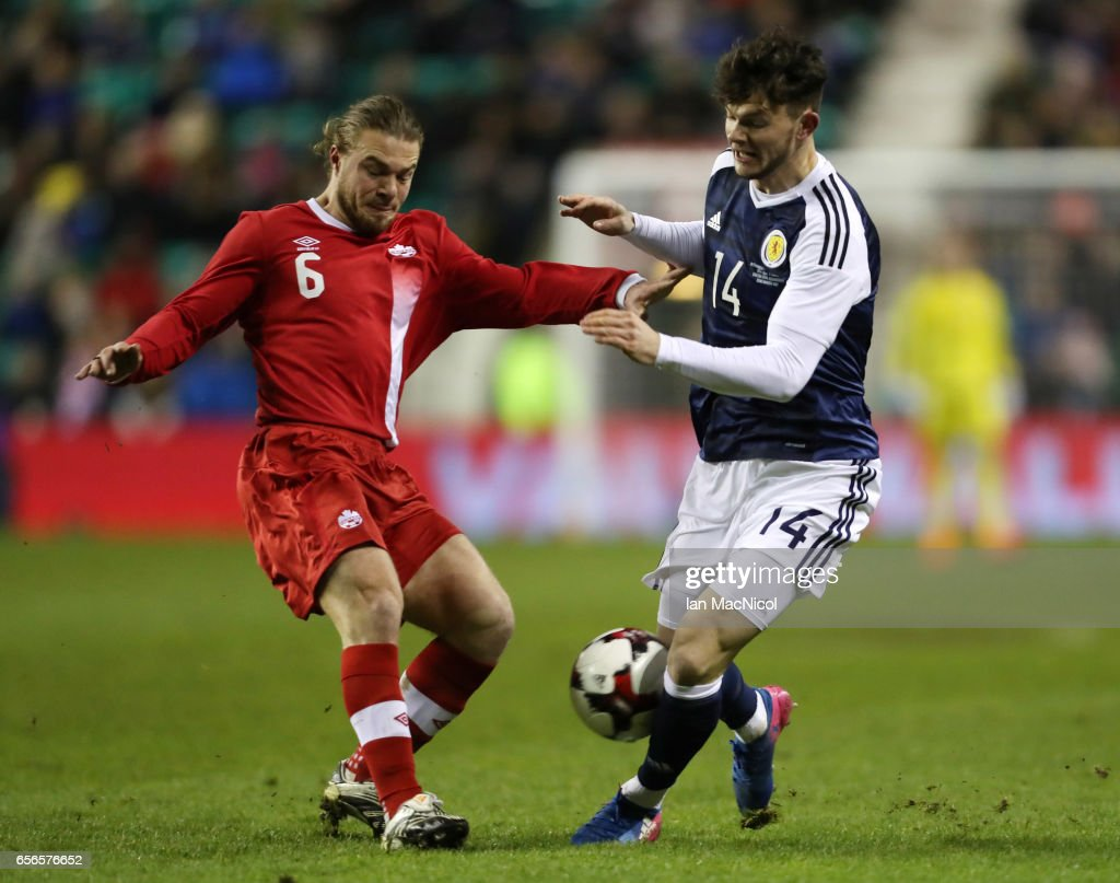 Samuel Piette of Canada vies with Oliver Burke of Scotland during the International Challenge Match between Scotland and Canada at Easter Road on March 22, 2017 in Edinburgh, Scotland.