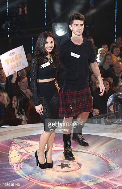Samuel Robertson and Lacey Banghard enter the Celebrity Big Brother House at Elstree Studios on January 3, 2013 in Borehamwood, England.