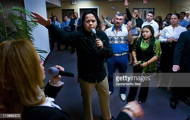 Samuel Rodriguez center preaches to his congregation as his wife Eva Rodriguez left translates in Spanish April 5 in Sacramento California Rodriguez...