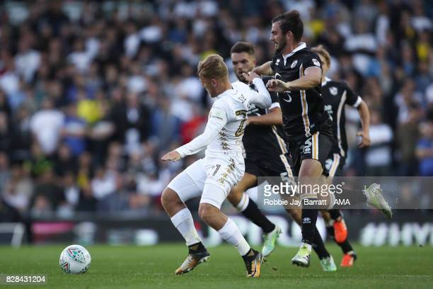 Samuel Saiz of Leeds United and Gavin Gunning of Port Vale during the Carabao Cup First Round match between Leeds United and Port Vale at Elland Road...