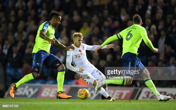 Samuel Saiz of Leeds United takes on Tom Huddlestone and Richard Keogh of Derby County during the Sky Bet Championship match between Leeds United and...