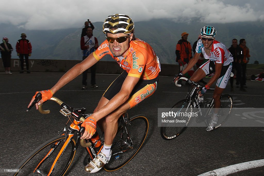 Samuel Sanchez (L) of Spain and team Euskaltel-Euskadi on his way to the stage victory from Jelle Vanendert (R) of Belgium and team Omega Pharma-Lotto as they approach the closing 2kms to the finish during Stage 12 of the 2011 Tour de France from Cugnaux to Luz-Ardiden on July 14, 2011 in Luz-Saint-Sauveur, France.