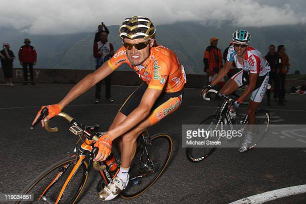 Samuel Sanchez of Spain and team Euskaltel-Euskadi on his way to the stage victory from Jelle Vanendert of Belgium and team Omega Pharma-Lotto as...