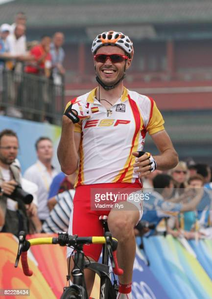 Samuel Sanchez of Spain celebrates winning the gold medal in the Men's Road Cycling event held on the Road Cycling Course during day 1 of the Beijing...