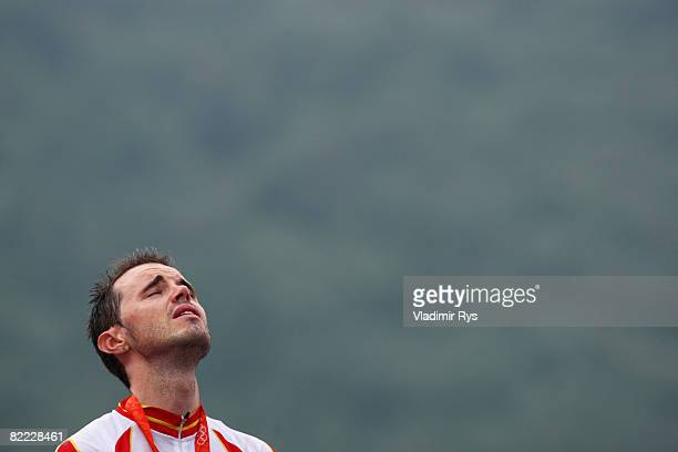 Samuel Sanchez of Spain cries as he listens to his national anthem after winning the gold medal in the Men's Road Cycling event held on the Road...