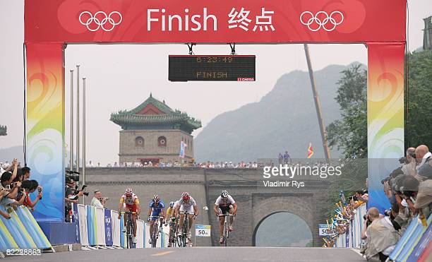Samuel Sanchez of Spain crosses the line to win the gold medal in the Men's Road Cycling event held on the Road Cycling Course during day 1 of the...