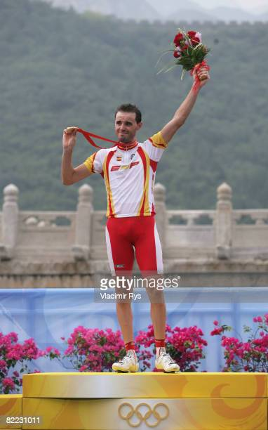 Samuel Sanchez of Spain stands ont he podium after winning the gold medal in the Men's Road Cycling event held on the Road Cycling Course during day...