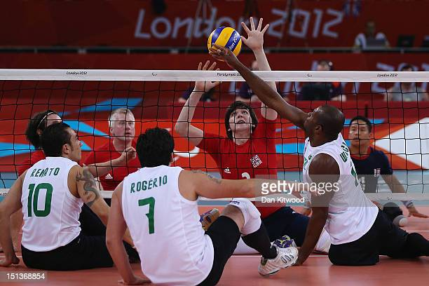 Samuel Scott of Great Britain plays a shot during the Men's Sitting Volleyball 58 Clasification match against Brazil on day 8 of the London 2012...
