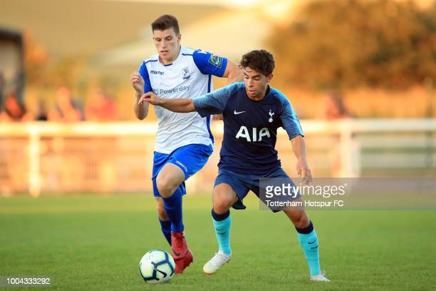 Samuel Shashoua of Tottenham Hotspur in action with Josh Davison of Enfield Town during the PreSeason Friendly match between Enfield Town and...